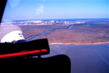 Grand Bay National Estuarine Research Reserve.North view showing southwestern corner of the reserve,warm-water effluent canal, and the Chevron oil refinery.  Taken during LSU aerial shoreline survey of October 1998.