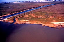 Grand Bay National Estuarine Research Reserve.Close-up of southwestern corner of reserve, warm-watereffluent canal, and the Chevron oil refinery.  Taken during LSU aerial shoreline survey of October 1998.
