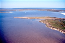 Grand Bay National Estuarine Research Reserve.East from Point aux Chenes Bay showing Rigolets with Mississippi/Alabama stateline along shore in background and Grand Bay, Alabama, in background. LSU aerial shoreline survey of October 1998.