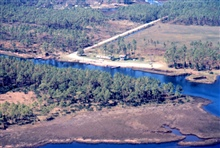 Grand Bay National Estuarine Research Reserve.Northeast showing Point-o-Pines boat launch on Bayou Cumbest and overturnedtrailer - Hurricane Georges damage. LSU aerial shoreline survey of October 1998.