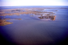 Grand Bay National Estuarine Research Reserve.East over Point aux Chenes Bay showing Crooked Bayou with shell middens(vegetated islands), and Middle Bay in background. LSU aerial shoreline survey of October 1998.