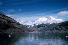 Photo #5 of Mount St. Elias sequence.Mount Saint Elias is one of the largest mountains visible from the sea on theNorth American continent.  It rises to a height of 18,008 feet in a distance ofless than 20 miles from sea level at Icy Bay.