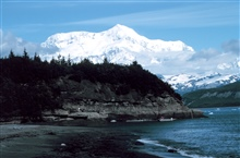 Photo #7 of Mount St. Elias sequence.Mount Saint Elias is one of the largest mountains visible from the sea on theNorth American continent.  It rises to a height of 18,008 feet in a distance ofless than 20 miles from sea level at Icy Bay.