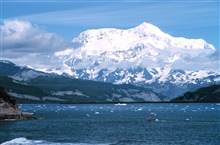 Photo #8 of Mount St. Elias sequence.Mount Saint Elias is one of the largest mountains visible from the sea on theNorth American continent.  It rises to a height of 18,008 feet in a distance ofless than 20 miles from sea level at Icy Bay.