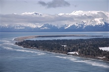 An aerial view of the south entrance to Icy Bay showing the great sandspit andthe endless surf of the Gulf of Alaska.