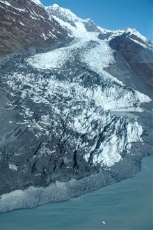 Aerial photograph. A glacier terminating in College Fjord.