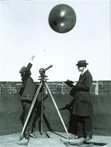 Early testing of hydrogen filled balloons for radiosonde measurementsTheodolite used to track balloon to limit of visibility
