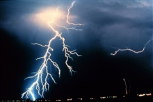 Multiple cloud-to-ground and cloud-to-cloud lightning strokes during night-time.Observed during night-time thunderstorm.