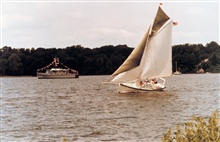 A Navy YP dressed for a holiday while the GALATEA, an old gaff-rigged cutter,travels the waters of the St. Mary's River