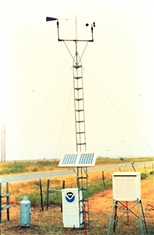 A solar-powered Surface Automated Measurement (SAM) site.These are deployed  to take measurements in and around severe weather.Tower instruments give wind direction and speed; rain gauge on left.White box houses temperature, relative humidity and pre