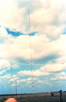 NSSL researchers mounted weather instruments on this very tall TV tower.This was the WKY-TV, Oklahoma City,  1602' tower.This tower was used during the 1970's and 1980's.