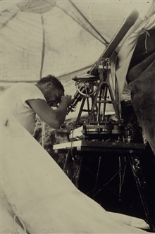 E. J. Brown using Davidson meridian telescope.Astro party of E. J. Brown.Part of World Longitude Campaign