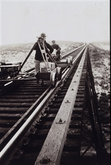 Observing from level mounted on velocipede.Level center-mounted on velocipede.Crossing trestle on Southern Pacific Railroad.Level party of C. A. Egner
