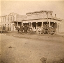 Building party leaving Lampasas, Texas.J.S. Bilby in light buggy.