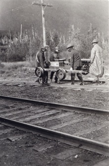 Leveling crew moving velocipede off tracks for approaching train.Level party of Herman Odessey.