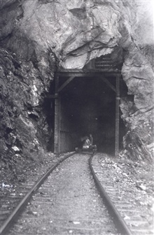 Leveling crew entering tunnel on velocipede.Hope they knew the train schedule.Level party of Herman Odessey.