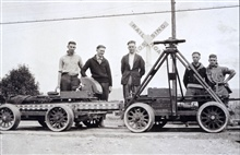 Leveling crew with inclined tripod mounted on velocipede.Level party of J.D. Crichton.