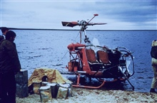 Crashed helicopter on the beach at Palm Springs camp.Triangulation party of Walter Helm