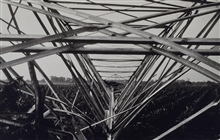Looking through the twisted steel of a 90-foot tower wrecked by a storm.Triangulation party of E. O. Heaton
