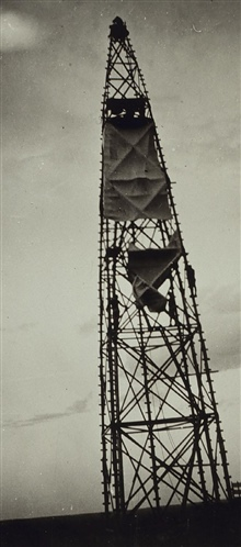 Wind tarps draping tower at Station Bippus.Wind tarps protect inner instrument tower from wind.Triangulation party of Earl O. Heaton