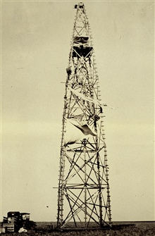 Removing wind tarps at Station Umbarger.Wind tarps protect inner instrument tower from wind.Triangulation party of Earl O. Heaton