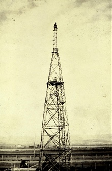 100-foot tower at Bozeman NW Base.Note man at top.Triangulation party of William M. Scaife