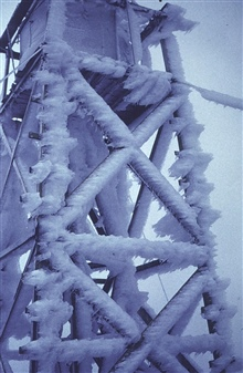 Tower at Station Indian covered with ice and frost.Station is just below the Arctic Circle.Triangulation party of Walter R. Helm
