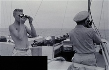 Launch hydrography three-point sextant fix.Surveying lagoon at Kwajalein Island.Party off of PIONEER