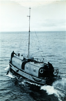 36' hydrographic launch with 30' Shoran antenna.Launch off of PIONEER