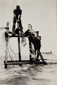Erecting a portable tide gauge platform at Kettle Cove.Glendon Boothe on right.Photo #1 of sequence