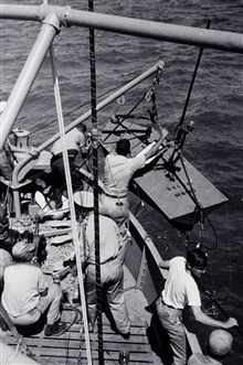 Full-crew effort to launch current meter buoy.Off of WAINRIGHT.Photo #1 of sequence