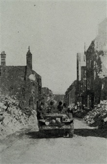 Survey party entering Vire, France, shortly after D-Day.17th FAOB.Photo from 17th FAOB Album
