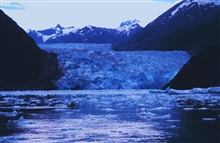 Whaler off of NOAA Ship JOHN N. COBB with Sawyer Glacier in the background.