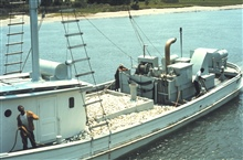 Menhaden fishing - a carrier vessel taking a load of menhaden to a processingplant