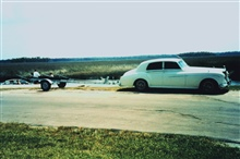 Fishing knows no class distinctions.  A Rolls Royce towing a boat trailer for aday's fishing.