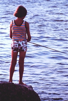 Young lady tries her luck fishing from the jetty at Port Aransas