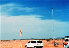 Installing a surface meteorological measurement tower in Arizona.