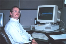 Mike Keltz, a computer programmer with the National Geodetic Program, at hiswork station.
