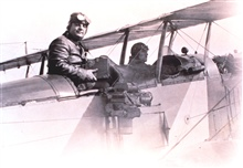 World War I era aerial photography with a side-mounted camera and open cockpitbi-plane.