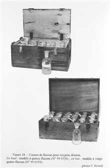 Figure 18.  Crates of bottles for water samples designated to study dissolvedoxygen.  The upper crate contains 15 bottles while the lower crate contains 24.Such crates have been used to store bottles with ground glass stoppersfor dissolved oxygen sam