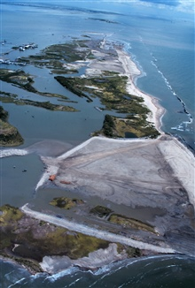 An aerial view of East Timbalier Island, the Gulf of Mexico is on the right. Thesandy brown areas in the middle of the photograph are the newly createdmarsh and dune habitat.