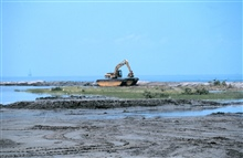 A piece of specialized equipment called a marsh buggy. The buggy was usedto bring sediments to the newly created marsh.