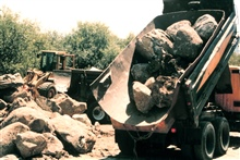 Heavy equipment places the boulders that were used to construct the fishpools.