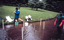 A scientist prepares to do sampling for gravel cleanliness and dissolved oxygenlevels.