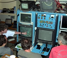 Pacific Ring of Fire Expedition. Left to right: Verena Tunnicliffe, Kim Juniper, Keith Shepherd and Bob Holland are gathered around the ROPOS console,identifying vent species on the seafloor.