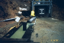 A mine opening, adit. Note the highly contaminated acidic mine drainagecoming from the left.