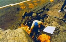 Spill response and clean-up at the oil spill site.