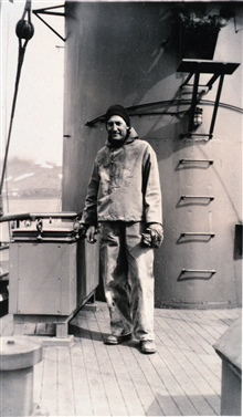 Lieutenant Raymond M. Stone as seen coming on board the C&GS; Ship EXPLORER,after spending a day ashore on Attu Island engaged in signal building andtopographic surveying.  July 4, 1945.  Snow still seen on background mountains.