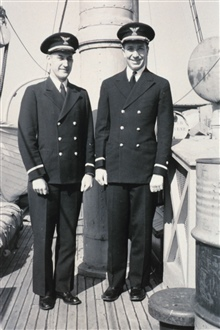 Ensign Raymond M. Stone and Ensign Norman Porter on board the C&GS; ShipLYDONIA at Norfolk, Virginia.  February 14, 1942.Porter joined the C&GS; Oct. 1, 1940 and Stone, December 16, 1940.  Porter wasassigned to the Marines while Stone remained in the