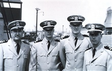 First modern C&GS; Officer Training Class on board the C&GS; Ship EXPLORER, June20, 1960.  L to R - Commander Raymond M. Stone, training officer, Ensign R.Lawrence Swanson, Ensign Bernard F. Karwisch, and Ensign Paul W. Hund, Jr.This first modern tra